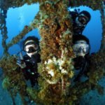divers having fun next to wreck in brunei asia borneo